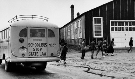 School bus delivering students to tar-paper building at Robert R. Moton High School, 1953